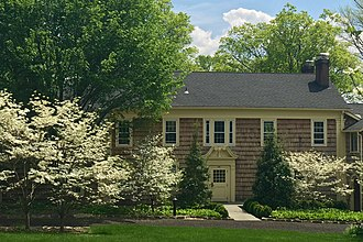Bamboo Brook Outdoor Education Center - Dogwoods in bloom in front of the Hutcheson House, home to Martha Brookes Hutcheson
