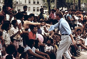 Dan Walker (politician) - Walker greeting constituents during the Bud Billiken Parade (1973). Photo by John H. White.