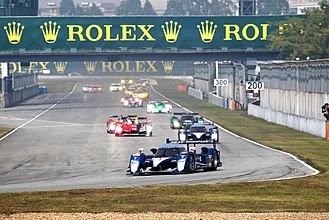 Peugeot 908 HDi FAP - The 908 of Franck Montagny and Stéphane Sarrazin leads the field at the start of the 2010 1000 km of Zhuhai. Montagny and Sarrazin won the race to seal the Teams' and Manufacturers' Cup for Peugeot.