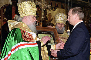 Patriarch Alexy II of Moscow - Alexy, in the Kremlin Cathedral of the Annunciation, presents Vladimir Putin with an icon of Saint Alexander Nevsky at the latter's presidential inauguration on 7 May 2000.