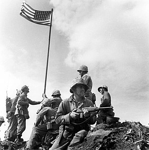 Military history of the United States during World War II - U.S. Marine Corps with the nation's flag during the Battle of Iwo Jima.