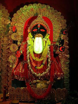 Kali Puja - A Kali Puja pandal with a replica of the Kalighat Kali Temple icon.