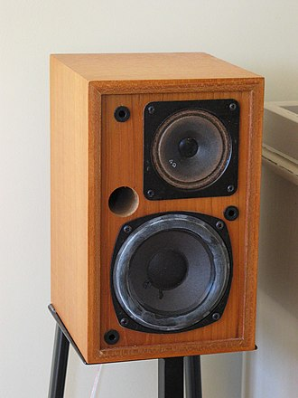 Bass reflex - A small Keesonic Kub speaker. With the front grille removed, the port is visible between the two drivers.