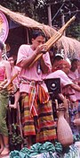 A Khene player wearing sarong and pakama at the Ubon Candle Festival