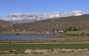 Meiringspoort - View of the Swartberg Mountain barrier from Klaarstroom in the arid north