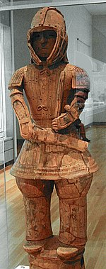 Terracotta figure of a man in armour.
