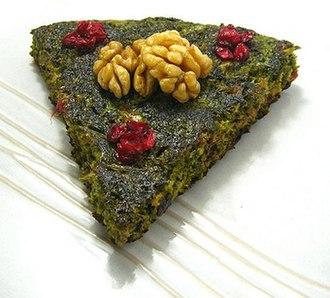 Kuku (food) - Kuku sabzi, with herbs and topped with barberries and walnuts