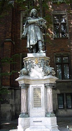 Monument to Nicolaus Copernicus next to the Jagiellonian University's Collegium Novum (New College) in Kraków.