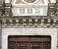 Latin inscription above a side portal - Duomo - Siena 2016.jpg