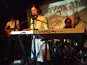 Laura Macfarlane - MacFarlane on keyboards and vocals with ninetynine, Northcote Social Club, 2007