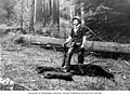 Lawrence D Lindsley with gun standing over dead bear and two cubs, location unknown, probably Washington, 1903 (LL 1067).jpg