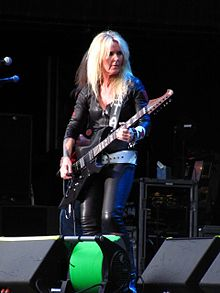 Lita Ford playing a guitar onstage