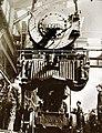 Locomotive 3261 is lowered onto wheels in repair shop (34624760471).jpg