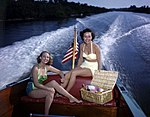 Lois Duncan Steinmetz (left) and Polly Gaines in a motorboat Sarasota, Florida.jpg