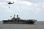 MH-60S Sea Hawk helicopters deliver supplies to USS Bataan during a vertical replenishment. (32348390582).jpg