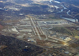 Fort Snelling (unorganized territory), Minnesota - Aerial photograph of Minneapolis–St. Paul International Airport showing much of the unorganized territory of Fort Snelling. The historic fort is by the confluence of the Mississippi and Minnesota toward the upper right of the photograph, and Fort Snelling National Cemetery is at center right.