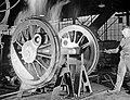 Machinist Checking Temperature of Locomotive Wheel, Texas and Pacific Railway Company (12801574744).jpg