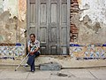 Man and Weathered Facade - Santiago de Cuba - Cuba (3794726966).jpg