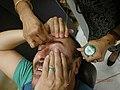 Man having his eyebrows threaded.jpg