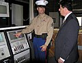 Marine Security Guard reviews the embassy's security alarm system with the regional security officer.jpg