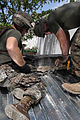 Marines, sailors sweat off a good deed during construction work in Haiti DVIDS311472.jpg