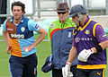 Mark Footitt and Aaron Finch (and umpire) (14152839500).jpg