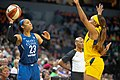 Maya Moore (23) looks for an open pass as she's guarded by Victoria Vivians (35) in the Lynx vs Fever game.jpg