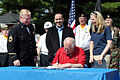 Medal of Honor recipient and retired U.S. Army Sgt. 1st Class Sammy Lee Davis, left, and Erica Borggren, Director of the Illinois Department of Veterans' Affairs, overlook as Illinois Gov. Patrick Quinn signs 130704-A-KL464-019.jpg