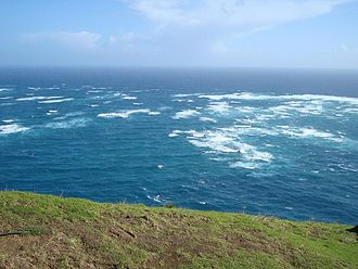 Cape Reinga - The Tasman Sea (left) meets the Pacific Ocean (right).