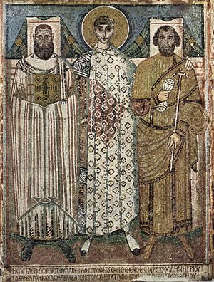 Miracles of Saint Demetrius - 7th-century mosaic from the cathedral of St. Demetrius in Thessalonica, depicting the saint with the bishop (left), often identified with John, and the governor (right) of the city