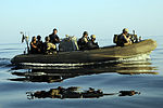 Members of USS Chosin's (CG 65) visit, board, search and seizure (VBSS) team and a Coast Guard maritime safety and security team approach a dhow in a rigid hull inflatable boat to prepare to board the vessel 100101-N-GQ684-147.jpg
