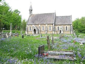 Merthyr Mawr - Merthyr Mawr Church. A medieval cross is to the left of the church