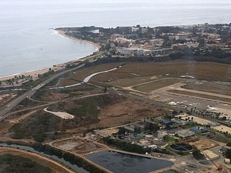Isla Vista, California - Aerial view of the remaining part of Mescalitan Island (left) and the Goleta Sanitary Sewage Treatment Plant, with UCSB in the distance