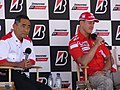 Michael Schumacher and Hiroshi Yasukawa 2005 United States GP (19872957).jpg
