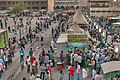 Migrant workers at Al Ghanim Central Bus Station.jpg