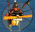 Miniplane paramotor over cape sounio greece.JPG