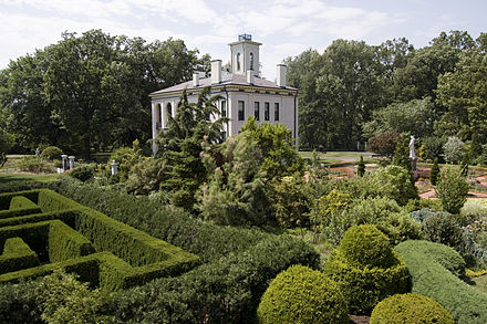 Tower Grove House seen here behind a hedge maze Missouri Botanical Garden.jpg