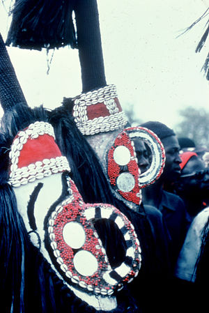 Art of Burkina Faso - Two female Mossi masks of the eastern style at a year-end ceremony in the village of Zegedeguin.