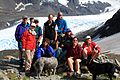 Motley collection of hikers posing near Raven Glacier (3816530162).jpg