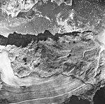 Muir Glacier, fragment terminus, outwash, and icebergs in the water, August 22, 1965 (GLACIERS 5685).jpg