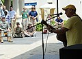 Musician Jimmy Buffet performs for members of Joint Task Force Haiti behind the U.S. Embassy in Port-au-Prince, Haiti, March 3, 2010 100303-N-HX866-002.jpg