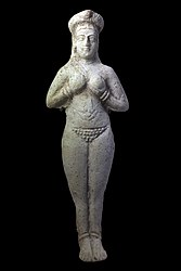 Moulded figurine. Naked woman, hands maintaining breasts. Susa.