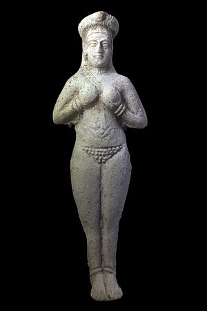 Aphrodite - Late second-millennium BC nude figurine of Ishtar from Susa, showing her wearing a crown and clutching her breasts