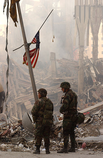 Rescue and recovery effort after the September 11 attacks on the World Trade Center - Two members of the New York Army National Guard standing at the World Trade Center site