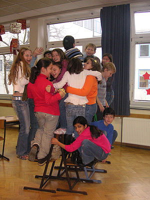 Musical chairs - The end of a game of the all-inclusive version, in which everyone plays but nobody loses