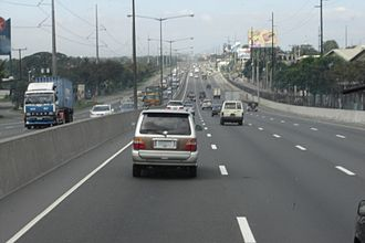 North Luzon Expressway - Northbound lane of NLEx in Lawang Bato-Lingunan area, Valenzuela. On the left is the Hermosa-Balintawak transmission line of National Grid Corporation of the Philippines. Note that this was taken before the construction of Dulalia Overpass, with an original steel pole tower 474 located between the location from where a new tower currently stands due to the construction of a said overpass. Also, most of the towers of Balintawak-Duhat segment of a said transmission line were painted with aluminum paint by National Grid Corporation of the Philippines last 2016