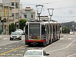 Outbound train at Taraval and 26th Avenue, June 2017.JPG