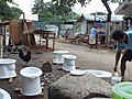 Painting of urine diversion pedestals for emergency toilets after typhoon Sendong (6754006767).jpg