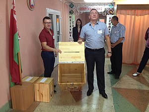 Belarusian parliamentary election, 2016 - Members of a commission showing empty ballot box before its closure, Slutsk