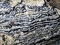 Partially devitrified rhyolitic obsidian (Roaring Mountain Member, Plateau Rhyolite, Upper Pleistocene, ~59 ka; Obsidian Cliff, Yellowstone, Wyoming, USA) 11 (45893857635).jpg